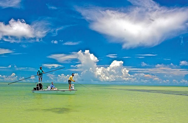 Photo of people fishing off a small boat in Key West