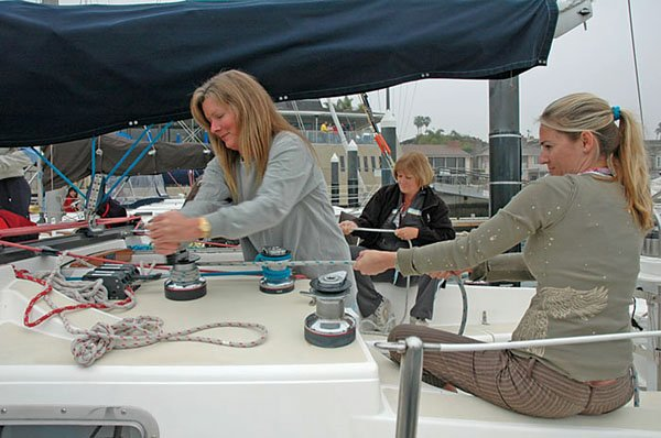 Photo of women working on a sailboat