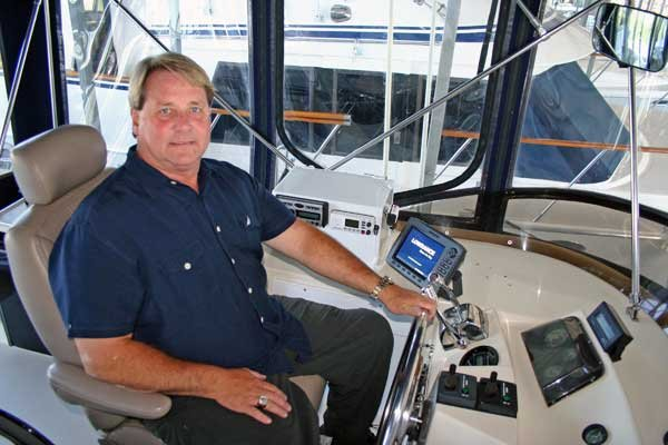 Photo of Richard Armstrong at the helm of his reconfigured boat