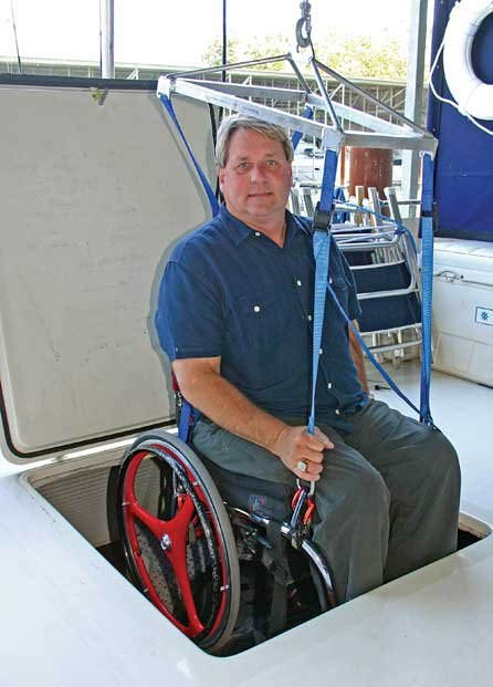 Photo of Richard Armstrong coming through his boat's hatch in his wheelchair