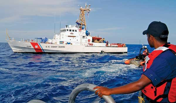 Photo of a Coast Guard cruiser at sea