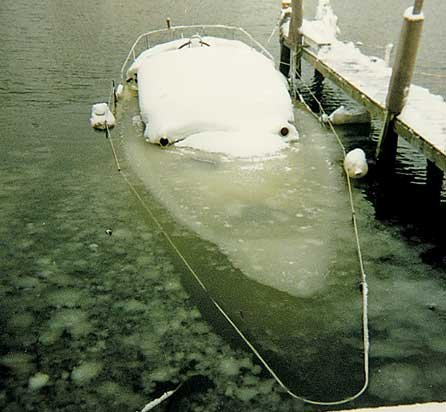 Photo of frozen boat with a cracked hull