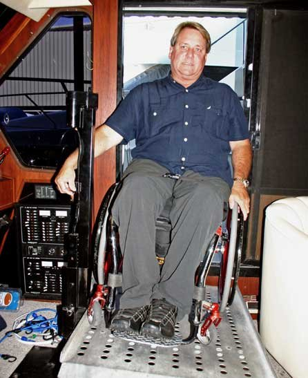 Photo of Richard Armstrong entering the Bluewater of his customized wheelchair ramp
