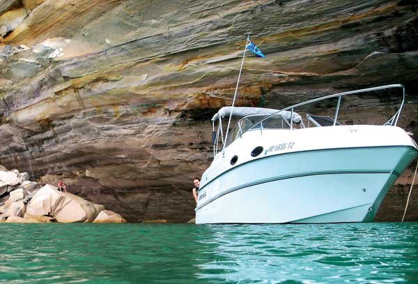 Photo of The gelcoat on a 24-foot Four Winns anchored along Pictured Rocks National Lakeshore in Michigan