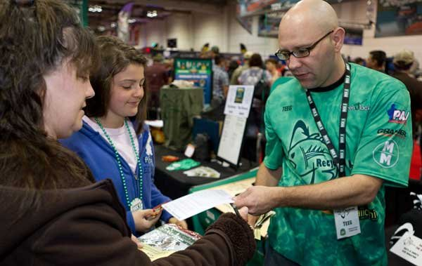 "Photo of Teeg Stouffer handing out information about the ""1 Million Stewards"" program"