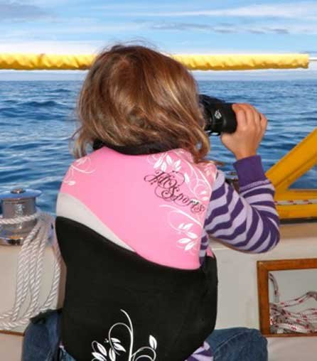 Photo of author's daughter looking throght binoculars
