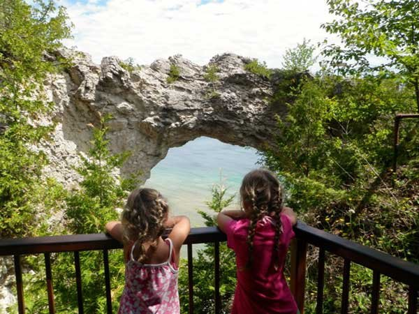 Photo Taking in the view through Arch Rock on Mackinac Island