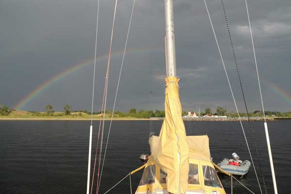 Photo of the Island Bounty with a rainbow in the sky