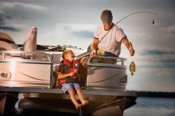 Photo of a father and son fishing in a boat