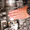 Thumbnail photo of touching engine to determine overheating