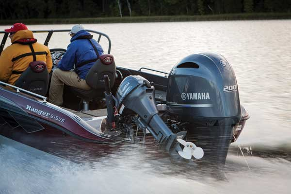 Photo of a 200-hp outboard, plus a 15-hp kicker motor