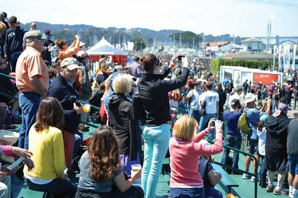 Photo of Spectators crowding the bleachers for America's Cup racing