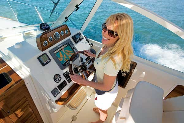 Photo of a pretty woman driving a boat