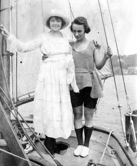 Photo of two young ladies, one in a swimming costume from the era, pose on Nellie H