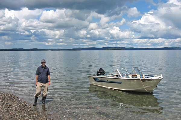 Photo of Tux and his boat boat on Minister's Island in Passamaquoddy Bay