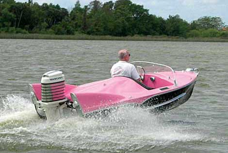 Photo of a pink motorboat on the water