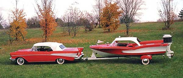 Photo of a 1958 red Glastron Seaflite trailered by a 1957 red Chevy