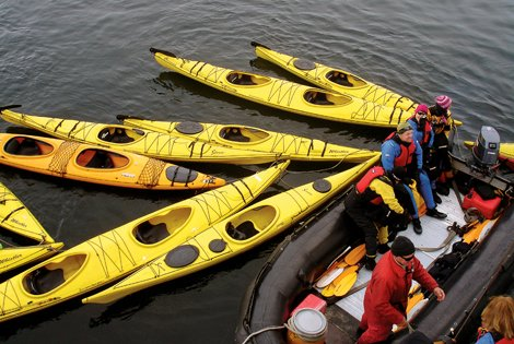 Photo of kayaks in arctic waters