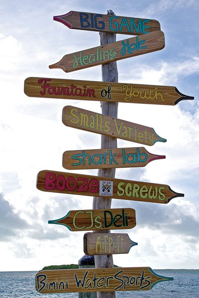 Photo of signposts that point to local attractions on Bimini