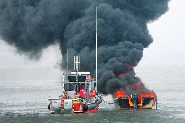Photo of a TowBoatUS vessel responding to a boat fire