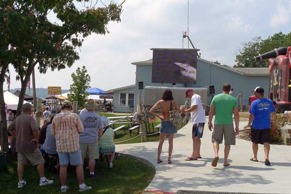 Photo of the crowd in front of the large screen TV outside Captain Ron's Bar and Grill