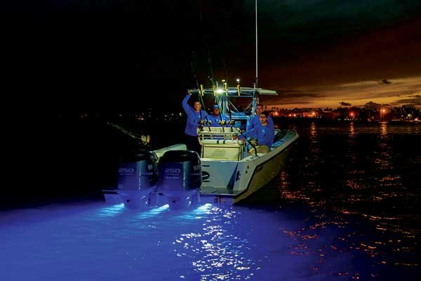 Photo of a center console of a boat showing the eerie glow of blue underwater LEDs