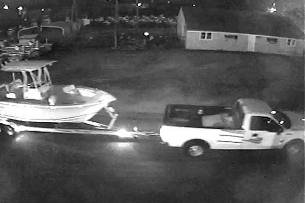 Photo of thieves making off with a trailerable boat are caught on a security camera