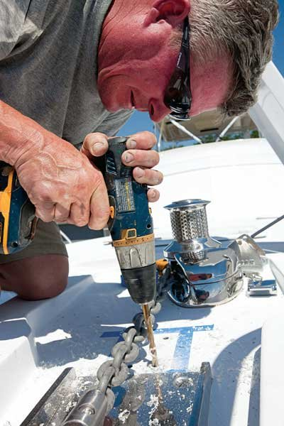 Photo of man making boat repairs