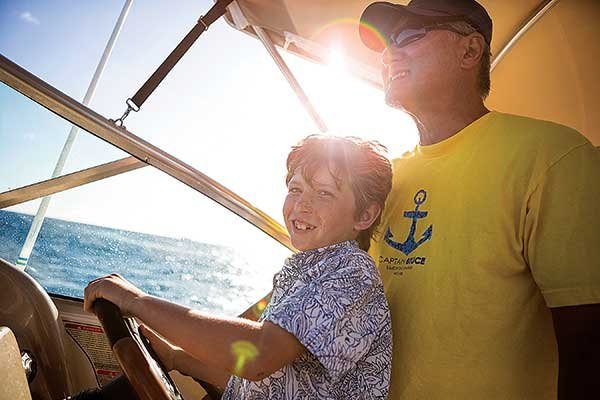 Photo of dad and son sailing