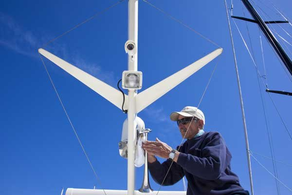 Photo of man repairing a boat mast