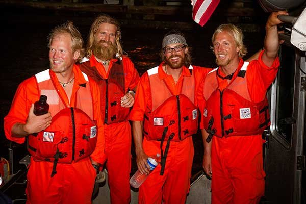 Photo of rowers rescued after their 29-foot rowboat capsized
