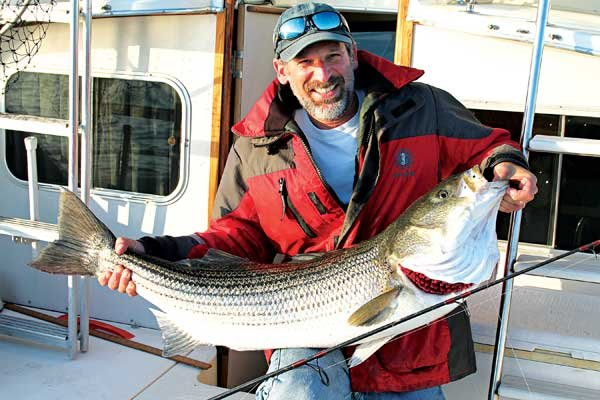 Photo of Lenny Rudow showing off a trophy striper