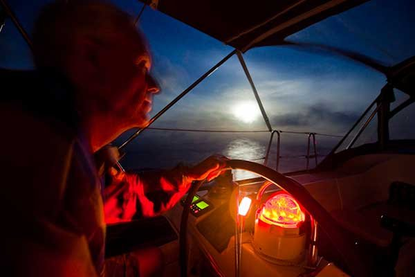 Photo of photographer self portrait while sailing at night