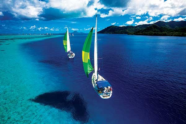 Photo of yachts sailing off Bora Bora