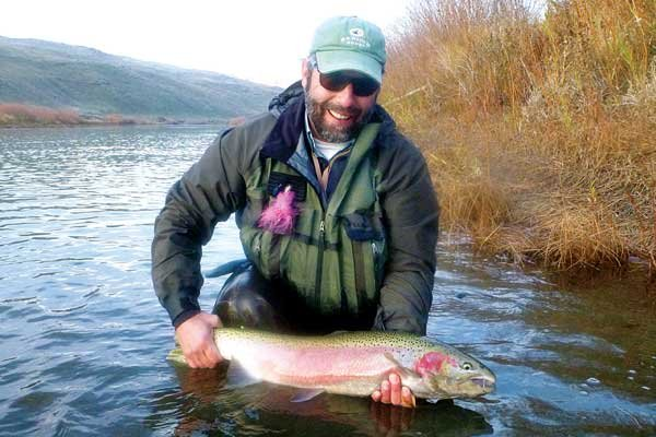 Photo of Chris Santella with his steelhead trout catch