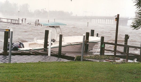 Photo of a swamped powerboat tied to the dock