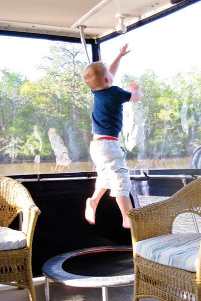 Photo of young child bouncing on a trampoline