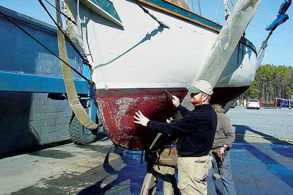 Photo of a boat inspection by a marine surveyor