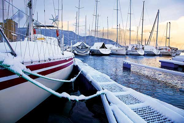 Photo of boats on the water in winter