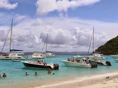 Photo of the BoatUS floatilla moored off a beach in the BVI