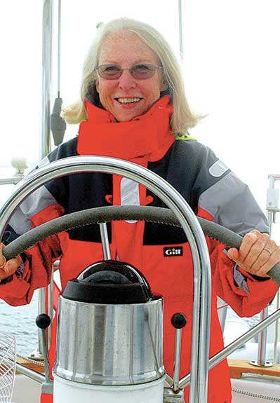 Photo of Ginny Vought at the helm of her Cal 39
