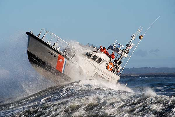 Photo of USCG ship cresting a Pacific roller off Cape Disappointment