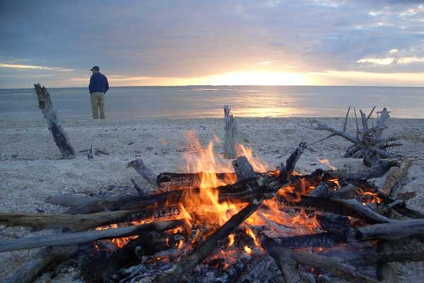Photo of a campfire on the beach