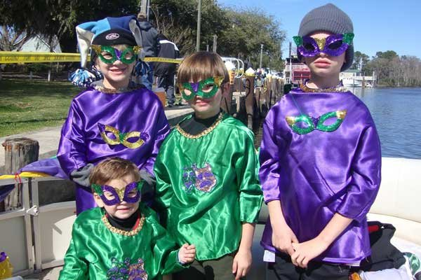 Photo of childern dressed for Mardi Gras
