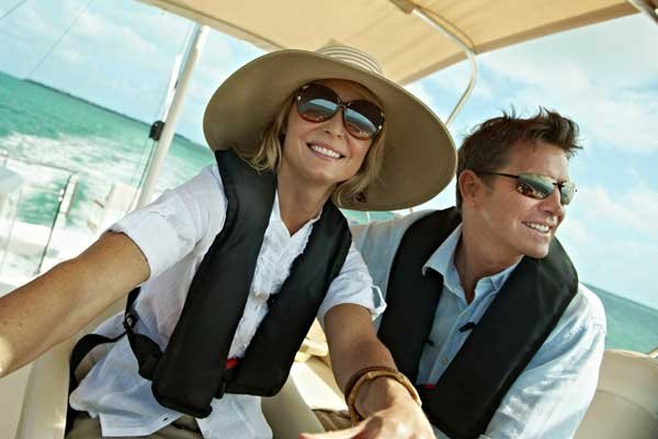 Photo of a happy couple enjoying powerboating