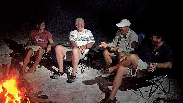 Photo of group gathered around the campfire