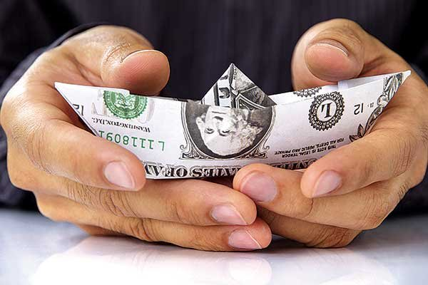 Thumbnail photo of holding boat shaped dollar bill