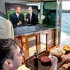 Watching TV on a boat