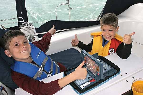 Photo of kids playing games on a boat