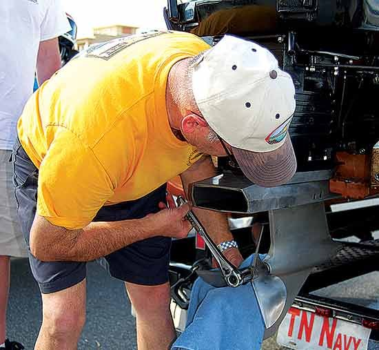 Photo of Roger Hinsdale installing the propeller on his Johnson Racing Special outboard